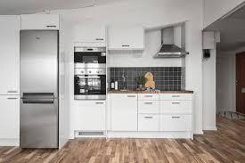 kitchen silver refrigerator microwave oven hardwood floor beaded