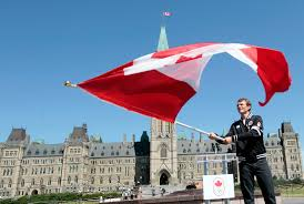 Canada Flag Bearer Simon Whitfield Following Canada U0027s Equestrian Team
