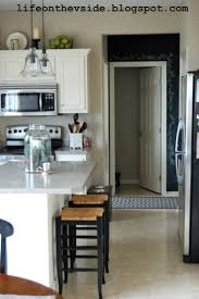 Painting Kitchen Cabinets Before Amp by Painting Kitchen Cabinets White Before And After