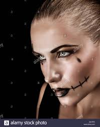 halloween portrait background portrait of aggressive young woman with creepy makeup and black