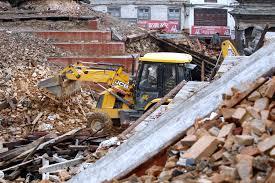 jcb announces 1 million backhoe donation to quake zone