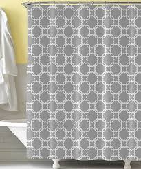 minimalist bathroom with gray white shower curtain and twelve