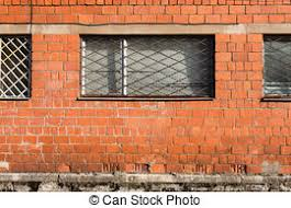 stock photographs of small dark basement window with rusted steel