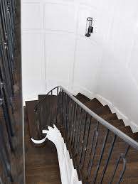 iron staircase hand rail transitional entrance foyer melanie