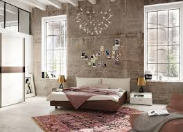 view in gallery modern bedroom design with a distressed wall
