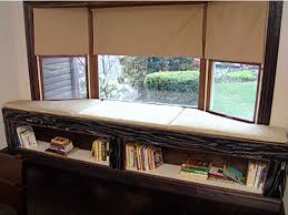 cushioned window bench and bookshelf hgtv