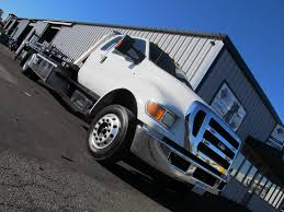 tow trucks for sale new used car carriers wreckers rollback