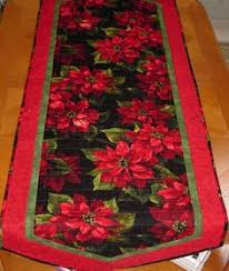 reversible quilted christmas table runner in red and silver
