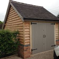 l shaped garages oak frame garage larch cladding and brick plinths farrall and