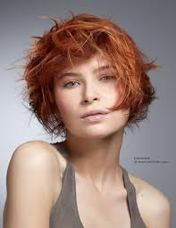 deconstructed bob hairstyle short hairstyle with deconstructed layers in a wearable red color