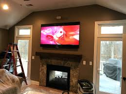 installing tv into brick fireplace mounted over surround sound