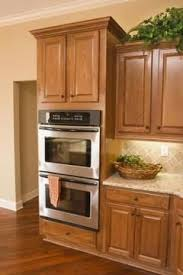 How To Restain Kitchen Cabinets by Best 25 Staining Wood Cabinets Ideas On Pinterest Wood Stain