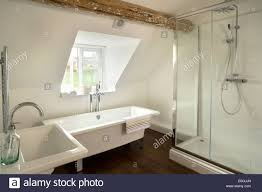 contemporary bathroom with a modern pedestal bath and large built contemporary bathroom with a modern pedestal bath and large built in shower in an attic room