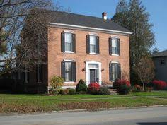 red brick house black shutters but what color door for the