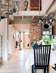 inspiring industrial interiors that features exposed brick walls