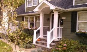 charming white front porch railing in a house painted in olive