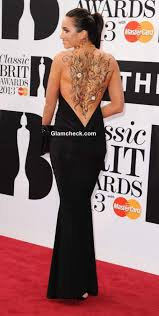 how to get laura wright s healthy hair laura wright shows off sexy body art in backless dress