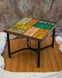 neat table made with all the old license plates you want to