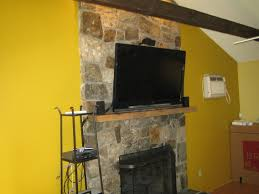 canaan ct u2013 tv install on natural stone above fireplace with