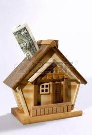 dollar bill being deposited into a house money box investment