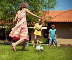 Family In The Garden Happy Family Playing Football In The Garden U2014 Stock Photo