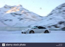 porsche winter porsche 911 targa 4s model year 2006 white driving side view