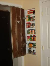 good use of space between studs in wall spice rack for the