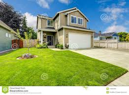 two story house exterior with front yard landscape stock photo