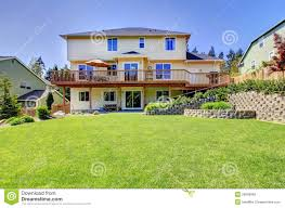 three story house backyard of three story house with fenced yard stock photo