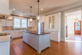 kitchen with white cabinets marble countertops wood countertop