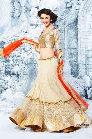 pavitraa astonishing cream golden and orange color net designer