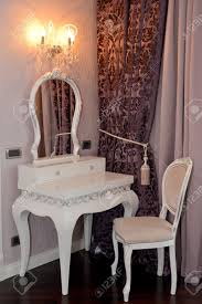 vintage style dressing room with classic white chair and dressing