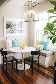 Round Table And Corner Banquette Dining Area Bright Pillows