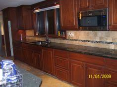 tile accents for kitchen backsplash venetian granite with noce travertine backsplash for the