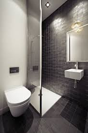 small shower stall and floating sink in a tiled bathroom add a