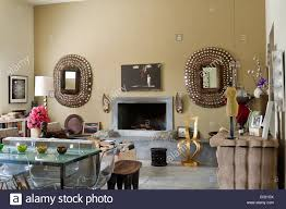 jewelled mirrors at fireplace in baja home of english interior