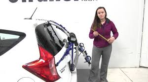 nissan versa reviews 2016 review of the thule archway trunk bike racks on a 2016 nissan