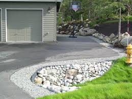 residential gravel driveway border rock culvert and perennial