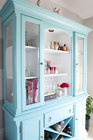 painted dining room hutch used as bar and entertaining supply