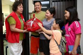 working together to help needy families singapore news