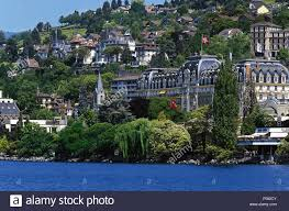 view of luxury hotel montreux palace on quayside at lake geneva