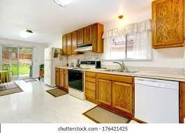 yellow kitchen wood cabinets bright kitchen wood cabinets tile floor stock photo edit