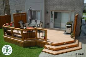 Front View Of A Large Low Single Level Deck With Privacy Screens - Backyard deck designs plans