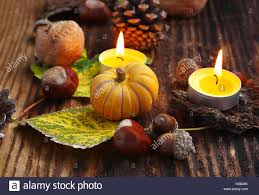 autumn decorations autumn decorations with pumpkins burning candles chestnuts stock