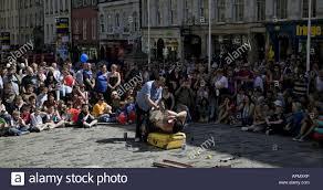 edinburgh fringe festival street performer lying on bed of nails