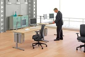 Adjustable Height Desk by Adjustable Height Desks Break The Monotony At The Office Officescene