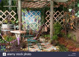 outdoor patio garden with trellis pergola quilt wall hanging tile