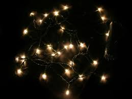 white lights strands happy holidays