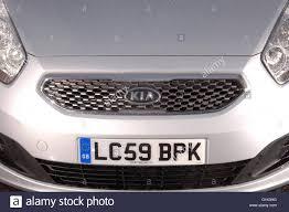 hatchback cars kia 2009 kia venga small hatchback car kia badge logo on grill stock