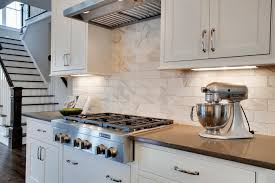 white shaker kitchen cabinets with white subway tile backsplash traditional white shaker cabinets marble subway tile hgtv